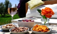 Nibbles by the pool at Villa Dinari in Marrakech