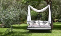 Relax in Villa Dinari's garden, your luxury villa in Marrakech