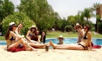 Relaxing by Villa Dinari's swimming pool