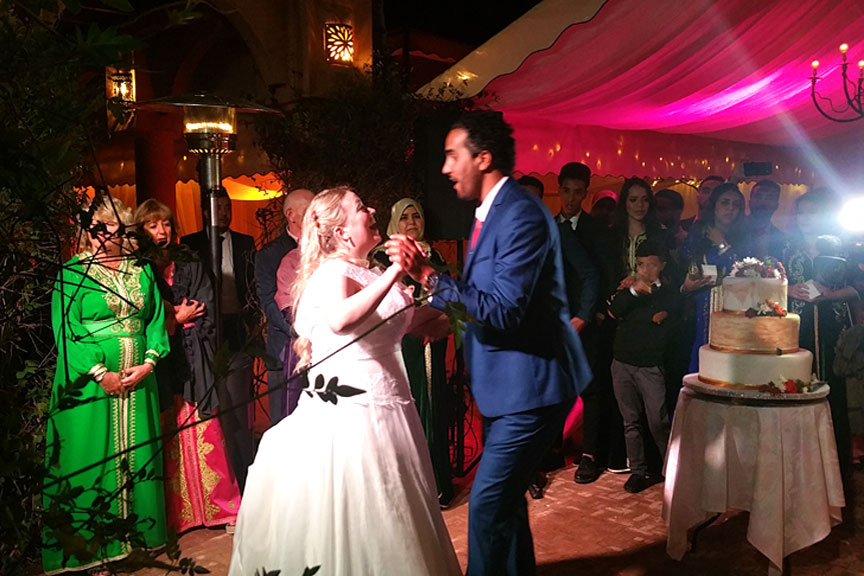 Happy couple dancing at their Marrakech wedding
